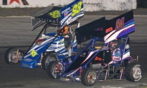 Chris Perley (93) and Joey Payne battle during Northeastern Midget Ass'n action at Star Speedway in New Hampshire in 2014. (Norm Marx Photo)