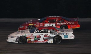 Nick Sweet (88VT) battles by Shawn Fleury (1VT) to take the lead with just under 10 laps to go on his way to his 13th career late model win at Thunder Road Int'l Speedbowl Thursday night. (Alan Ward Photo)