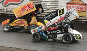 Daryn Pittman (9) battles Tim Kaeding during the SPEED SPORT World Challenge Saturday at Knoxville Raceway. (Frank Smith Photo)