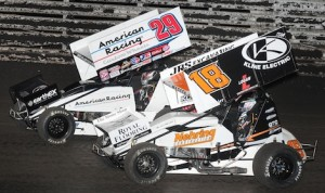 Ian Madsen (18) battles his brother, Kerry, during Sunday's Capitani Classic at Knoxville Raceway. (Frank Smith photo)