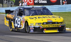 Marcos Ambrose on his way to victory Saturday at Watkins Glen Int'l. (Dennis Bicksler Photo)