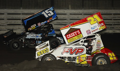 Brian Brown (21) battles Sam Hafertepe Jr. for the lead Thursday night at Knoxville (Iowa) Raceway. (Mark Funderburk photo)