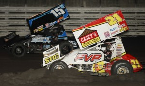 Brian Brown (21) battles Sam Hafertepe Jr. during Thursday's Knoxville Nationals preliminary event at Knoxville Raceway. (Mark Funderburk Photo)