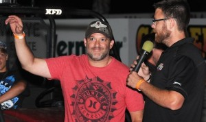 Tony Stewart (left) is interviewed by Bryan Hurlbert Monday at Southern Iowa Speedway. Stewart returned to the track one year after breaking his leg there. (Frank Smith photo)