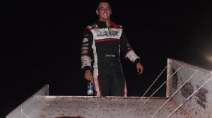 Derek Hagar celebrates his eighth USCS feature win of the 2014 season with a wing walk in victory lane. (Jacob Seelman photo)