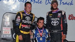 Rico Abreu, center, poses on the podium after winning the Belleville Nationals on Saturday night. Runner-up Zach Daum, right, and third-place finisher Tracy Hines look on. (Lonnie Wheatley photo)