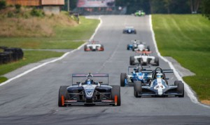 Conner Kearby leads the Wings 'n Things field into turn one at Summit Point Motorsports Park Sunday. (Bill Stoler Photo)