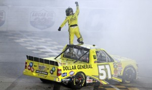 Kyle Busch celebrates after winning the NASCAR Camping World Truck Series race Saturday at Chicagoland Speedway. (HHP/Alan Marler Photo)