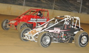 Shane Cockrum (66) battles Jerry Coons Jr. on  his way to winning Sunday's USAC Silver Crown Series Ted Horn 100 at the DuQuoin State Fairgrounds. (Ken Simon Photo)