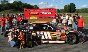 """Derrick O'Donnell celebrates his second straight Thunder Road """"King of the Road"""" title following his second place finish in the Coca-Cola Labor Day Classic on Monday. (Alan Ward Photo)"""
