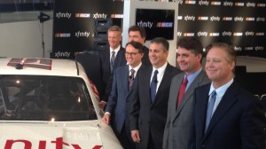 NASCAR Chairman and CEO Brian France, far right, poses with Comcast and NASCAR executives at a Wednesday announcement at the NASCAR Hall of Fame in Charlotte, N.C. The series announced that its secondary series will become the Xfinity Series in 2015. (Aaron Burns photo)