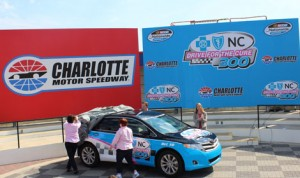 Charlotte Motor Speedway President Marcus Smith helps breast cancer survivors reveal the new logo for the Drive For The Cure 300 NASCAR Nationwide Series event at Charlotte Motor Speedway. (Adam Fenwick Photo)
