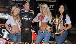 Tracy Hines enjoys the spoils of victory Friday at Canyon Speedway Park. (TWC photo)