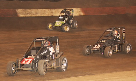 Christopher Bell (71) leads Darren Hagen (56) and Chad Boat during Thursday's Turkey Night Grand Prix. (Doug Allen photo)