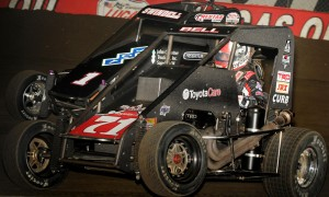 Christopher Bell (71) races under Sammy Swindell during Saturday's Lucas Oil Chili Bowl Midget Nationals finale at the Tulsa Expo Raceway. (Frank Smith Photo)