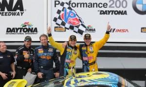 Brothers Matt Plumb and Hugh Plumb celebrate after winning Friday's Continental Tire SportsCar Challenge BMW Performance 200 at Daytona Int'l Speedway. (Dave Moulthrop)