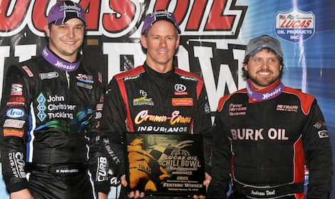 Jerry Coons Jr. (center) won Thursday's Chili Bowl Nationals feature. He shared the podium with runner-up Andrew Deal (right) and third-place Kevin Swindell. (Frank Smith photo)