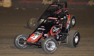 Tracy Hines (4) fends off Kyle Cummins during Friday's AMSOIL USAC National Sprint Car Series event at East Bay Raceway Park. (Al Steinberg Photo)
