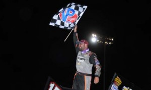 Donny Schatz celebrates after winning Saturday's World of Outlaws Sprint Car Series race at Silver Dollar Speedway. (Tom Parker Photo)