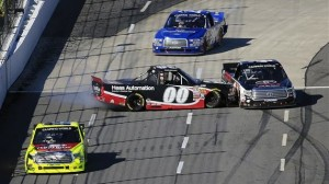Cole Custer (00) spins after contact with Matt Crafton while battling for the lead late in Saturday's NASCAR Camping World Truck Series Kroger 250 at Martinsville (Va.) Speedway. (NASCAR photo)