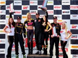 Spencer Pumpelly (center) earned his first Pirelli World Challenge GTS class triumph Saturday in St. Petersburg, Fla. (PWC Photo)