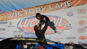 Justin Russell celebrates with his son on Saturday at Lucas OIl Speedway. (CB Race Photos)