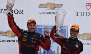 Eric Curran and Dane Cameron celebrate after winning Saturday's TUDOR United SportsCar Championship event at The Raceway at Belle Isle. (Al Steinberg Photo)