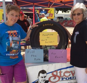 (From left) Danette King Amstein and Naomi King are accepting donations at the Steve King Foundation booth at Knoxville Raceway to support injured driver Kevin Swindell. (Haven Kerchner Photo)