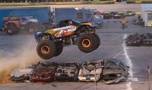 """""""Hurricane Force"""" leaps over a pile of cars during the Monster Truck show at Southern National Motorsports Park. (Alicia Hackett/Frameworks Photography Photo)"""