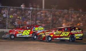 Stewart Friesen (66) battles Matt Hulsizer Thursday night at Rolling Wheels Raceway Park. (Don Romeo photo)