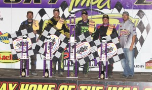 Champions crowned Saturday night at the 33rd annual IMCA Speedway Motors Super Nationals fueled by Casey's, from left, were Jason Wilkinson, Hobby Stock; Clint Luellen, Northern SportMod; Kyle Strickler, Modified; and Dustin Larson, Stock Car. At right is IMCA President Brett Root. (Carl Larson Photo)