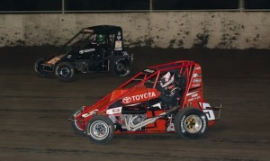 Tanner Thorson (67) passes Zach Daum en route to winning Saturday's Gold Crown Nationals at Tri-City Speedway. (Connor Hamilton photo)