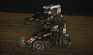 Christopher Bell (71) battles Justin Peck during Saturday's POWRi Lucas Oil National Midget Series event at Spoon River Speedway. (Mike Ruefer Photo)