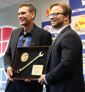 Ray Evernham (left) receives the Smokey Yunick Award from Speedway Motorsports Inc. COO and Director and Charlotte Motor Speedway General Manager Marcus Smith Thursday at Charlotte Motor Speedway. (Adam Fenwick Photo)