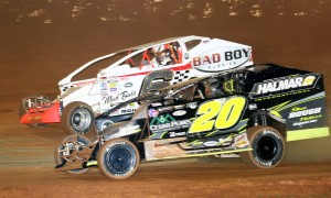 Brett Hearn (20) battles alongside Max McLaughlin during Super DIRTcar Series action at the Bad Boy Buggies World Finals last November at The Dirt Track at Charlotte. (Dick Ayers Photo)