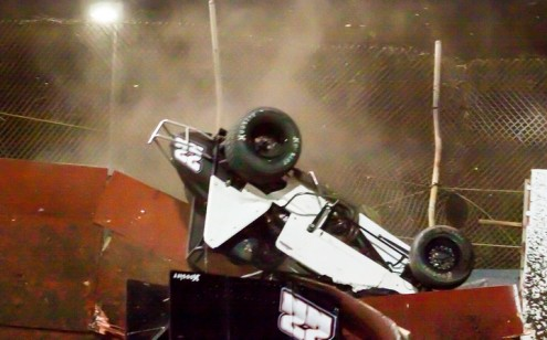 Shawn Murray's car continues to tumble as it re-enters the speedway. (R.E. Wing Photo)