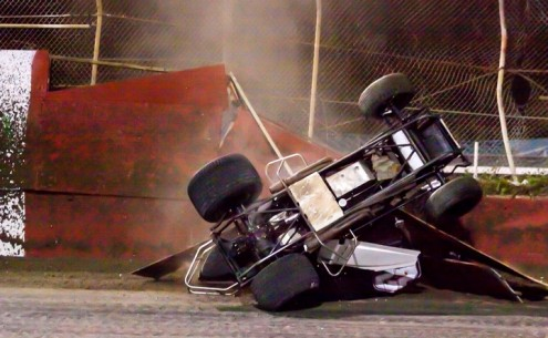 Shawn Murray's car lands back in the speedway after nearly exiting the track through the fence. (R.E. Wing Photo)