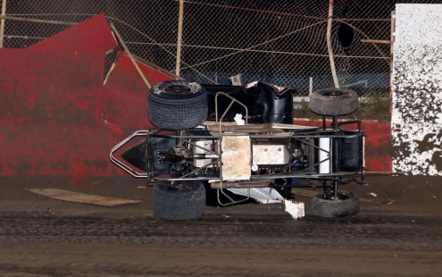 Shawn Murray's car finally comes to a stop on its side after a wild ride at East Bay Raceway Park. (R.E. Wing Photo)