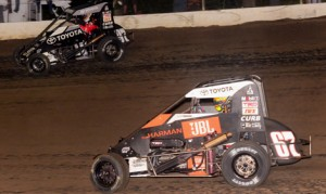 Tanner Thorson (67) races under Spencer Bayston during Friday's Lucas Oil POWRi National Midget Series event at Valley Speedway. (Ken Simon Photo)