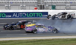 Bobby Santos (44) avoids the crashing cars of Woody Pitkat (85) and Todd Szegedy (15) to win Friday's Whelen All-Star Challenge at New Hampshire Motor Speedway. (HHP/Alan Marler Photo)