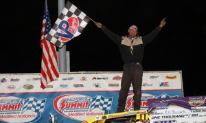 Ray Bollinger celebrates his victory in Monday's DIRTcar Summit Racing Equipment Modified Nationals event at LaSalle Speedway. (Jim DenHamer Photo)