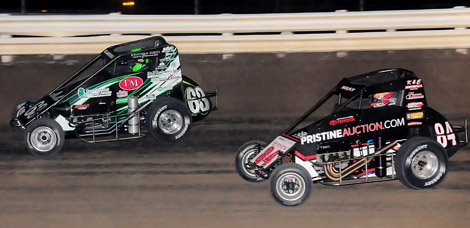 Bryan Clauson (63) battles Chad Boat during Saturday's Belleville Midget Nationals feature. Clauson was later seriously injured in a crash while leading the race. (Ken Simon Photo)