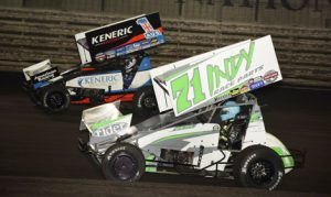 Jamie Veal (71) battles Kerry Madsen during Saturday's 5-hour Energy Knoxville Nationals main event at Knoxville Raceway. (Mark Funderburk Photo)
