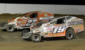 Danny Johnson (27j) battles Tim Fuller Saturday night at Weedsport (N.Y.) Speedway. (Don Romeo photo)