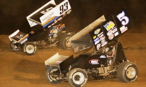 Sheldon Haudenschild (93) races around Byron Reed Saturday night at Ohio's Attica Raceway Park. (Julia Johnson photo)