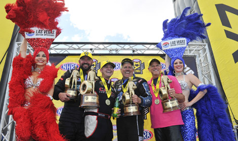 (From left) Shane Gray, Steve Torrence, John Force and Jerry Savoie celebrate after winning in their respective NHRA classes on Sunday at The Strip at Las Vegas. (NHRA Photo)