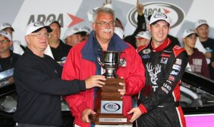 Chase Briscoe (right) receives the ARCA championship trophy from ARCA President Ron Drager (center). (Ivan Veldhuizen photo)