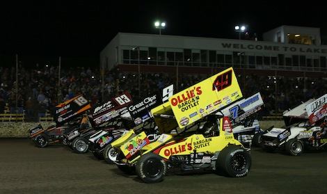 Brad Sweet (49) leads the World of Outlaws Craftsman Sprint Car Series field on a four-wide parade lap at Lakeside Speedway. (Ivan Veldhuizen photo)