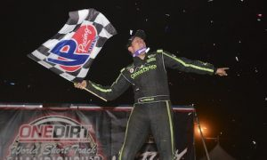 Kyle Strickler celebrates wildly after winning Saturday's UMP modified feature at The Dirt Track at Charlotte. (Chris Seelman photo)