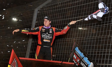 Jason Johnson celebrates in victory lane Friday night at The Dirt Track at Charlotte. (Frank Smith photo)